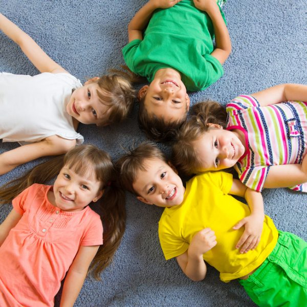 photodune-4902000-cute-little-children-lying-on-floor-s-600x600